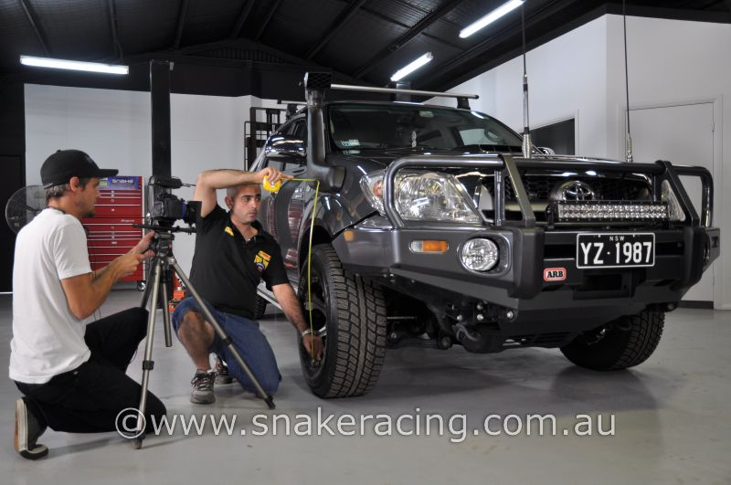 Simon from Tough Dog measuring vehicle height for Toyota HiLux suspension lift