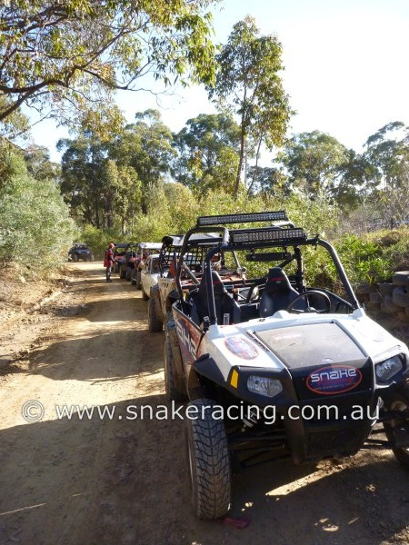 Snake Racing RZR in line of Polaris UTV racing at Awabawac Park Twilight Khanacross
